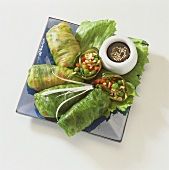 Stuffed lettuce leaves with rice & vegetable filling, soy sauce