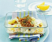 Fish gratin with breadcrumb crust and oranges