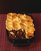 Beef and mushroom ragout with toasted bread topping