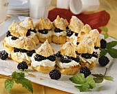 Profiteroles with blackberry and cream filling