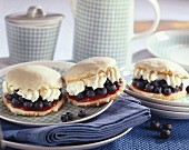 Filled blueberry cakes with white chocolate icing