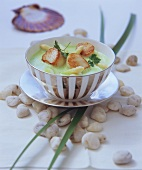 Creamed asparagus and pea soup with fried scallops