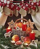 Small basket with gingerbread, candles and Advent calender