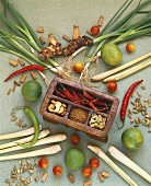 Still life with lemon grass, chilli, galangal, limes etc.