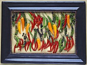 Chillies and bunches of peppercorns in frame