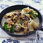Lamb and vegetable ragout with capers, mace and raisins