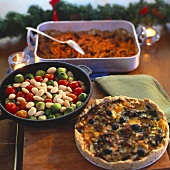 Warm bean salad, kale and olive quiche, vegetable bake