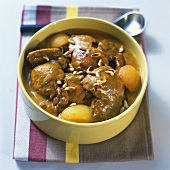 Curried chicken with apricots and pine nuts