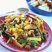 Biryani-style rice dish with vegetables, nectarine, nuts