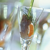 Marinated herring with dill, served in a glass
