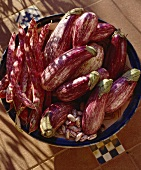 Striped aubergines and red and white speckled beans