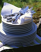 Fabric napkins and cutlery on stacked plates