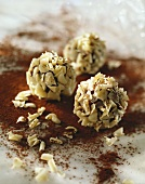 Chocolate truffles coated in white chocolate flakes