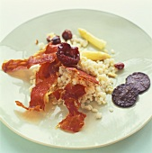 Pearl barley with dried plums and Parma ham