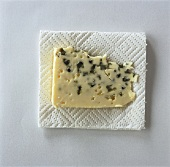 A slice of Roquefort on paper towel