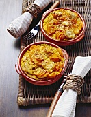 Gratin of couscous, carrots & turkey breast with sesame seeds