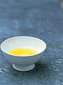 Sweet almond oil in a white porcelain bowl