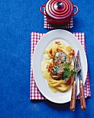Veal escalope with saffron foam on spaghetti & tomatoes