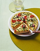 Courgette tart, partly sliced
