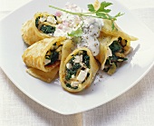 Pancakes filled with spinach, sheep's cheese, pine nuts