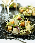 Mixed green salad with Parmesan and croutons