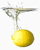A lemon falling into water