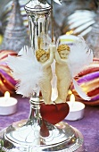 Angel hanger hanging on a candlestick