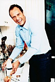 Cheerful man working in kitchen