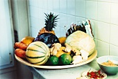 Bowl of fruit and vegetables on a kitchen counter