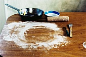 Flour and cooking utensils on table top