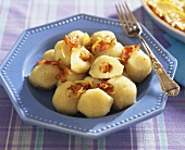 Pyzy (Polish potato dumplings) filled with bacon