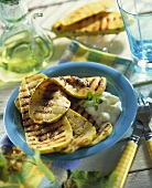 Grilled slices of squash with garlic yoghurt