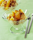 Rice pudding with peach slices and flaked almonds