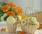 Tischgestecke mit spanischem Mohn, Schneeball & Margeriten