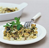 Mushroom gratin with capers, olives & anchovies