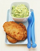 Pork escalopes and mashed potatoes with broccoli