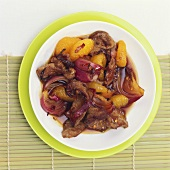 Lamb, mandarin oranges and red onions in chilli caramel