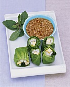 Lettuce rolls with tofu & radish filling & sesame ginger sauce
