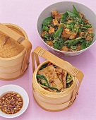 Tofu with mangetout and steamed tofu on vegetables