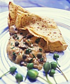 Crêpe with mushroom and caper sauce