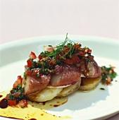 Matjes herrings with tomato salad on potato slices