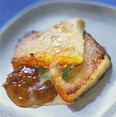 Warm Ostkaka (curd cake) with jam (Sweden)