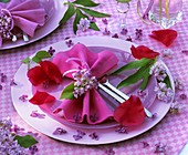 Place-setting with lilac and peony petals