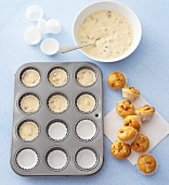 Savoury muffin mixture in muffin tin