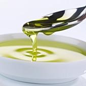 Olive oil in spoon