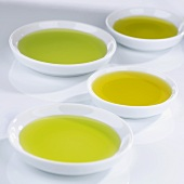 Small bowls of different kinds of olive oil