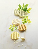 Slices of different herb and spiced butters