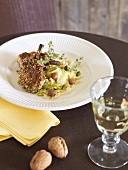 Lamb chops with nut crust on savoy cabbage
