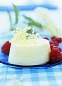 Elderflower champagne cream with berry sauce