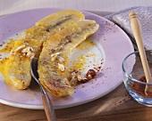 Fried bananas with cayenne pepper sauce on cinnamon yoghurt